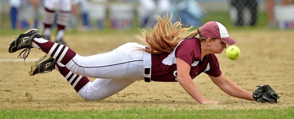 Staff photo by Michael G. Seamans   Edward Little's Taylor Depot dives for a ground ball against Messalonskee during a Class A North semifinal game Saturday in Oakland.