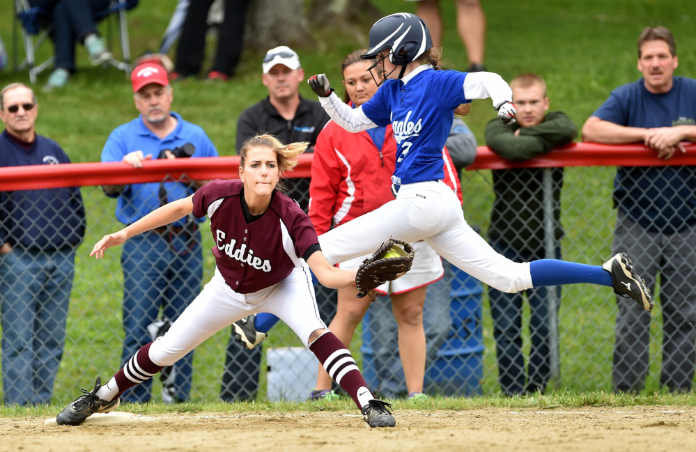 Staff photo by Michael G. Seamans   Messalonskee's Makenzie Charest tries to beat out the throw to Edward Little first baseman Jordan Reynolds (16) during a Class A North semifinal game Saturday in Oakland.
