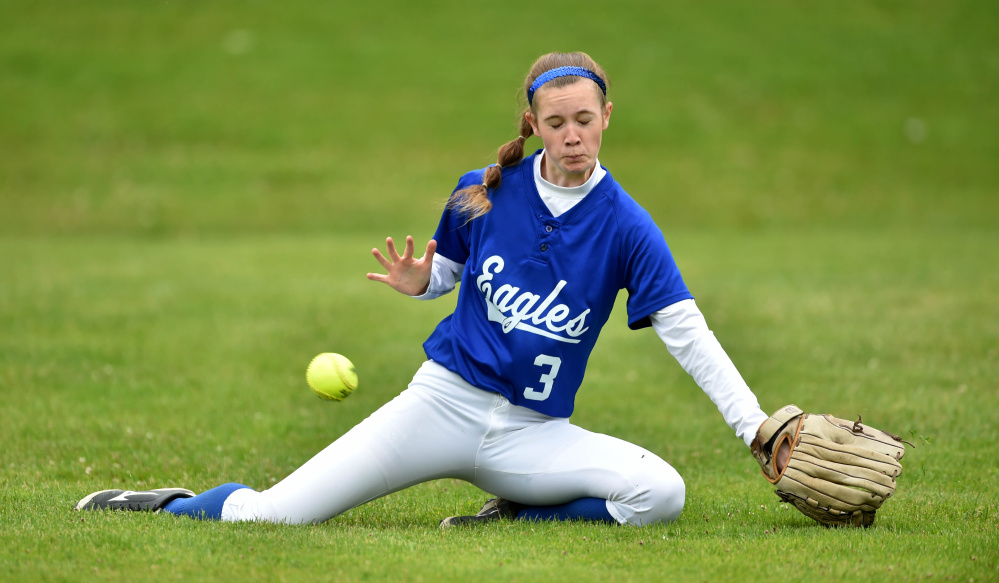 Staff photo by Michael G. Seamans   Messalonskee's Makenzie Cherest misses a fly ball hit by Edward Little's Kylie Bureau during a Class A North semifinal game Saturday in Oakland.