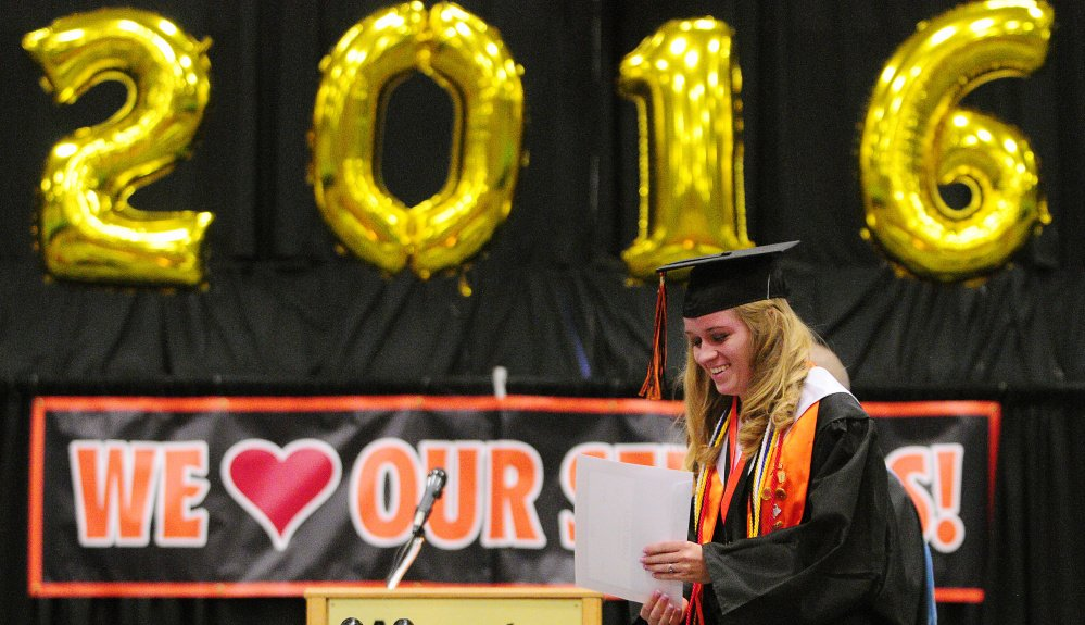 Cassie Trask returns to her seat Saturday after winning a scholarship during the Gardiner Area High School graduation at the Augusta Civic Center.