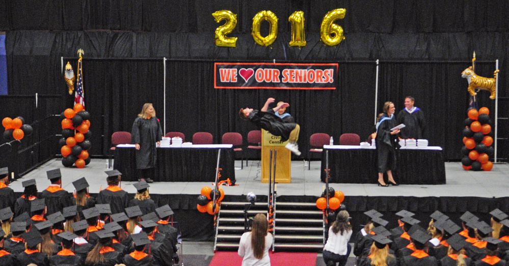 Peter Del Gallo does a back flip Saturday after receiving his diploma during the Gardiner Area High School graduation at the Augusta Civic Center.