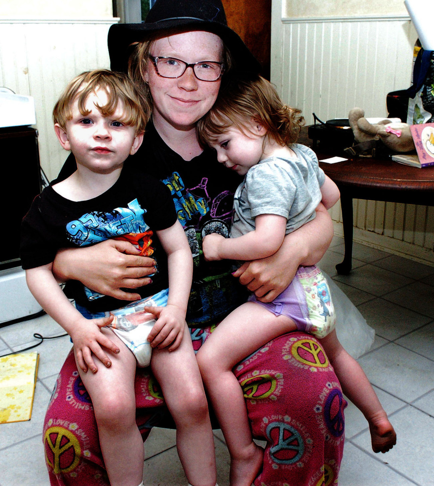 Melissa Blodgett with two of her children, Caspian, left, and Emilia, at their apartment in Winslow on Sunday.