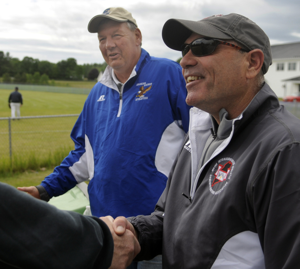Erskine Academy athletic director Doran Stout, left, introduces his replacement, Chuck Karter, during a baseball game Thursday in South China. Stout is retiring after 22 years as the school's athletic director.