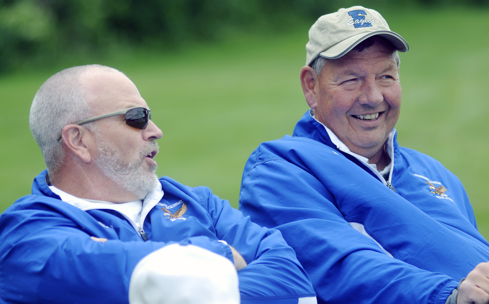 Erskine Academy assistant baseball coach Scott Corey, left, speaks with athletic director Doran Stout during a baseball game Thursday in South China.