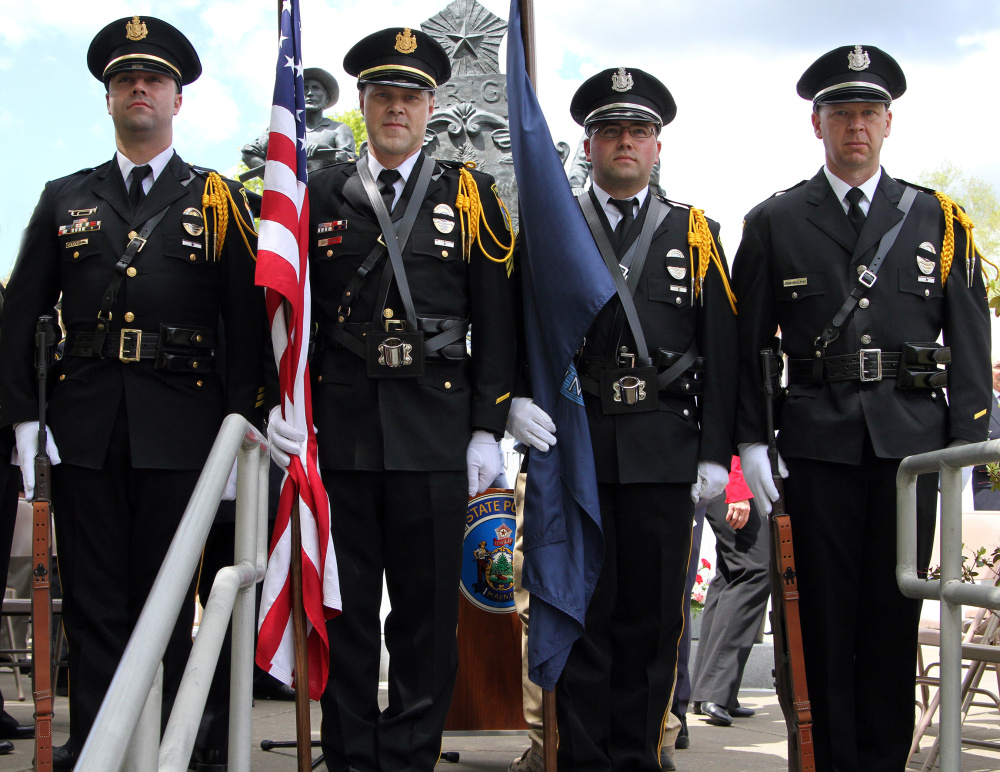 Winslow Police Honor Guard standing in front of the memorial after the ceremony. From left, are Sgt. Haley Fleming, Sgt. Brandon Lund, Officer Charles Theobald and Officer John Veilleux.