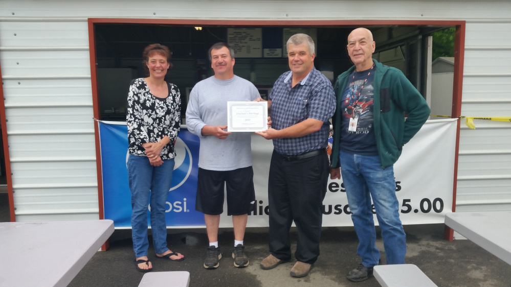 Spectrum Generations Muskie Commuity Center recently parented a Certificate of Recognition to Scott Dorval for all his hard work, dedication and community support. From left, are Angela DeRosby, Scott Dorval, Bob Marin and Roger Derosier.