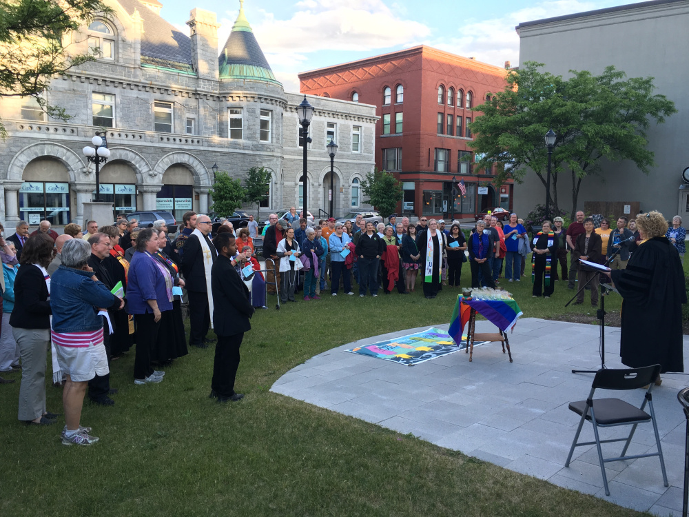 More than 100 people gathered Tuesday evening in Augusta's Market Square Park for a ceremony organized by the Capital Area Multifaith Association to remember the victims of the Orlando shootings.