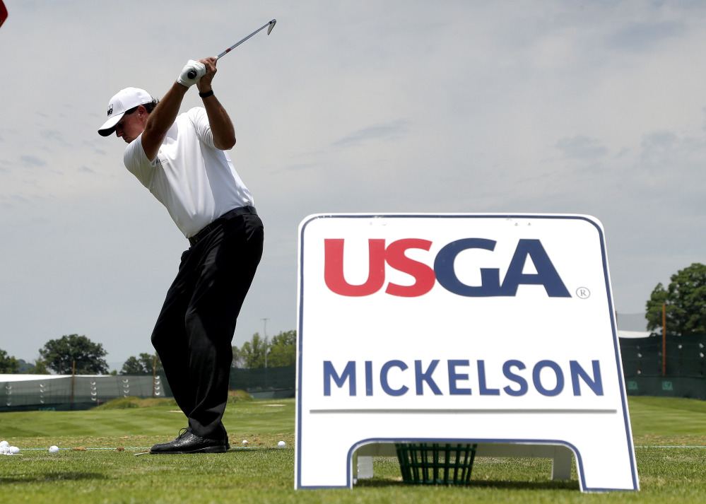 Phil Mickelson hits on the range while practicing for the U.S. Open on Wednesday at Oakmont Country Club in Oakmont, Pennsylvania.