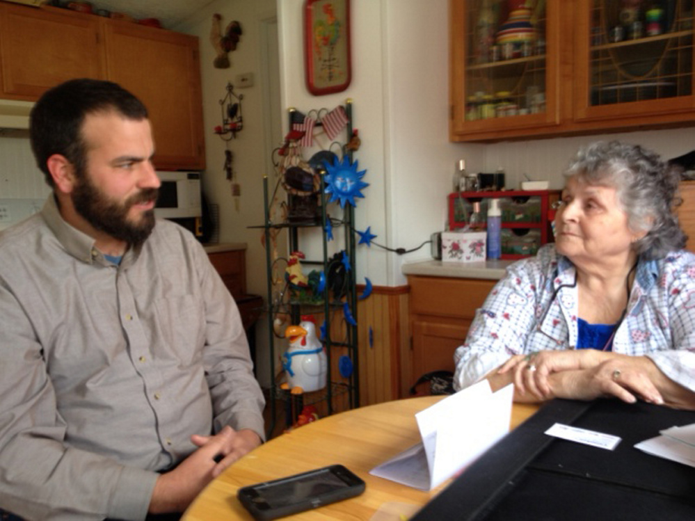 Rep. Jeff McCabe talks to Skowhegan resident Jan Martin on Tuesday in her home about her mold problem and the difficulty she's had getting help.