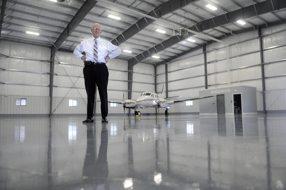 William H. Perry, a proprietor of Maine Instrument Flight, stands on Thursday in the new corporate hangar at the firm's headquarters in Augusta. The firm stores its KingAir charter plane in the state-of-the-art hangar, which also will host corporate and private jets.