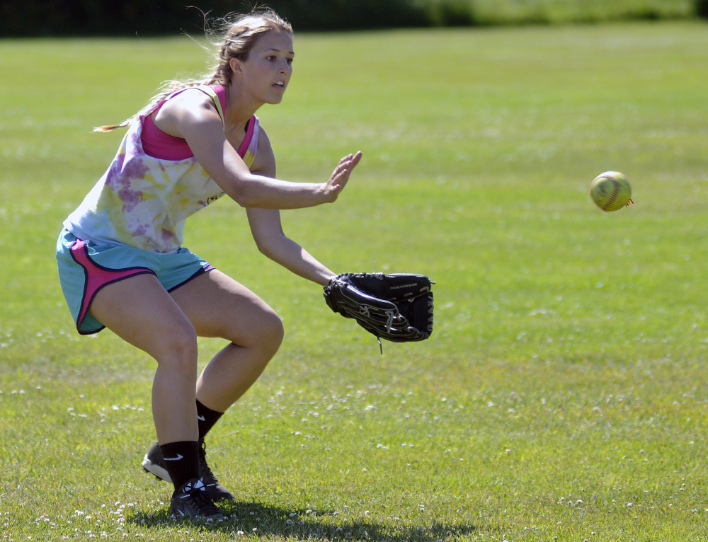 Richmond senior center fielder Autumn Acord fields a ball during practice Thursday in preparation of the Class D state championship game Saturday against Stearns.
