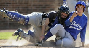 Valley runner Collin Miller slides into home as Searsport catcher Barrett Grant tries to apply the tag during the Class D South title game Wednesday at St. Joseph's College in Standish.