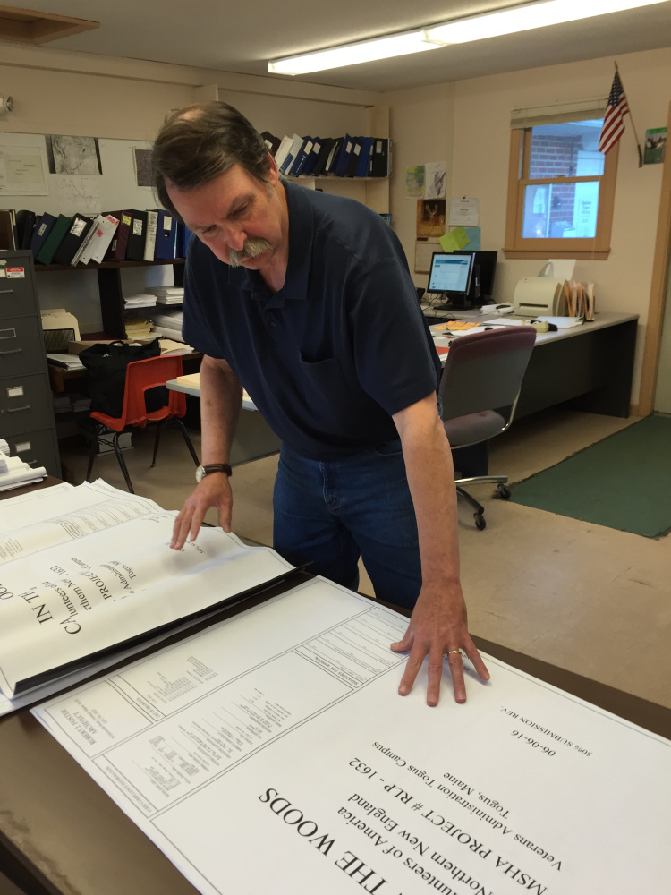 Bill Butler, the code enforcement officer for the town of Chelsea, reviews the plans for the Cabin in the Woods project for homeless veterans.