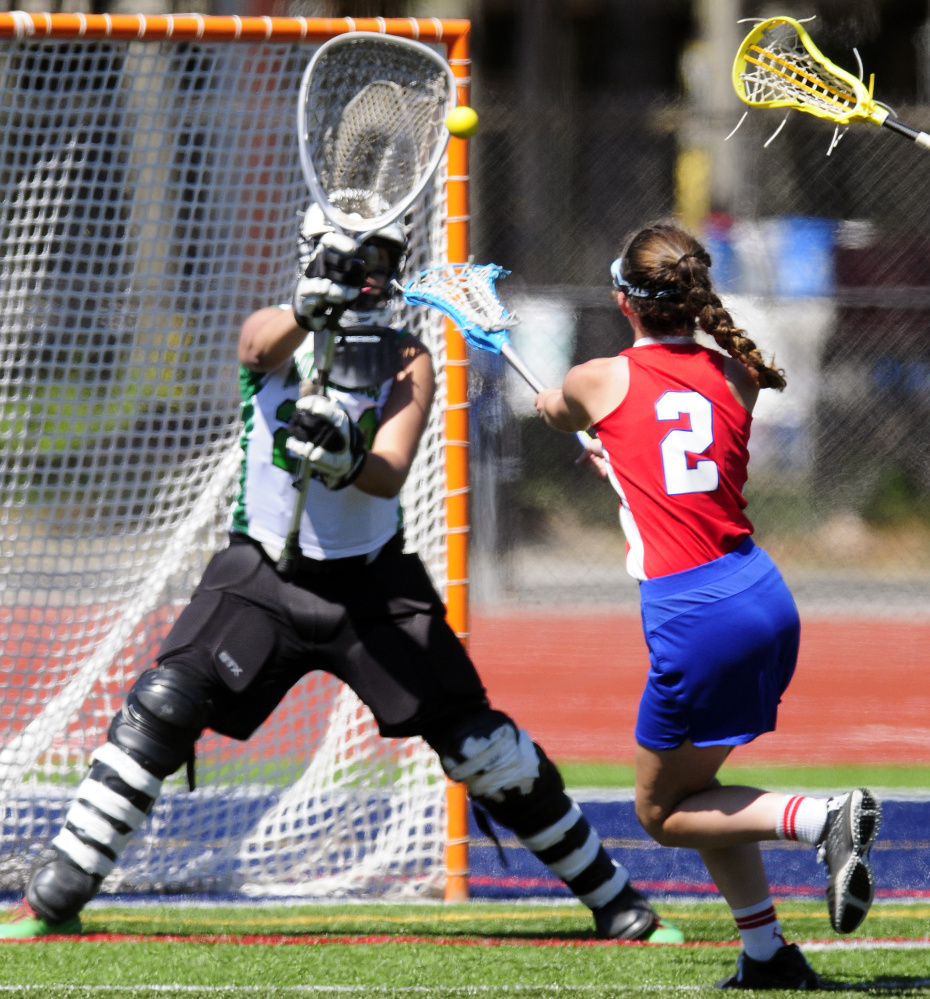Massabesic goalie Lydia Wasina blocks a shot by Messalonskee's Kailtlyn Smith during the Class A state title game Saturday morning at Fitzpatrick Stadium in Portland.