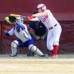 Cony's Kassidy Turgeon swings at a pitch as Madison catcher Aly LeBlanc hauls it in during the Class A/B senior all-star game Thursday night at Cony Family Field.