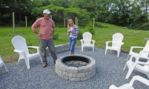 Gene Carbona, left, listens as Veronica Carbona talks about fire pit during a tour Thursday at the Barn at Silver Oaks Estate in Winthrop.