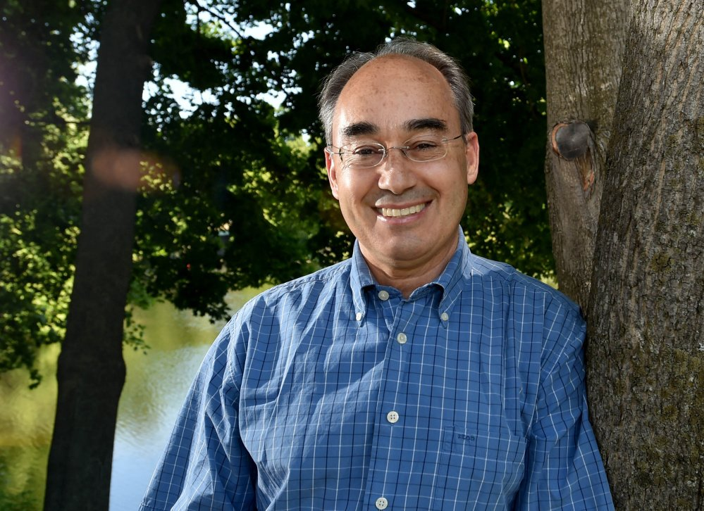 Rep. Bruce Poliqiun poses for a portrait Saturday on the banks of Messalonskee Lake in Oakland.