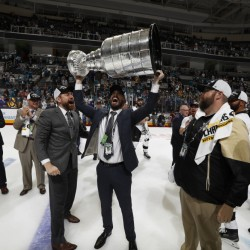 Pittsburgh video coach Andy Saucier, a 2004 Waterville Senior High School graduarte, hoists the Stanley Cup into the air after the Penguins beat the host San Jose Sharks 3-1 in Game 6 of the finals at SAP Center.