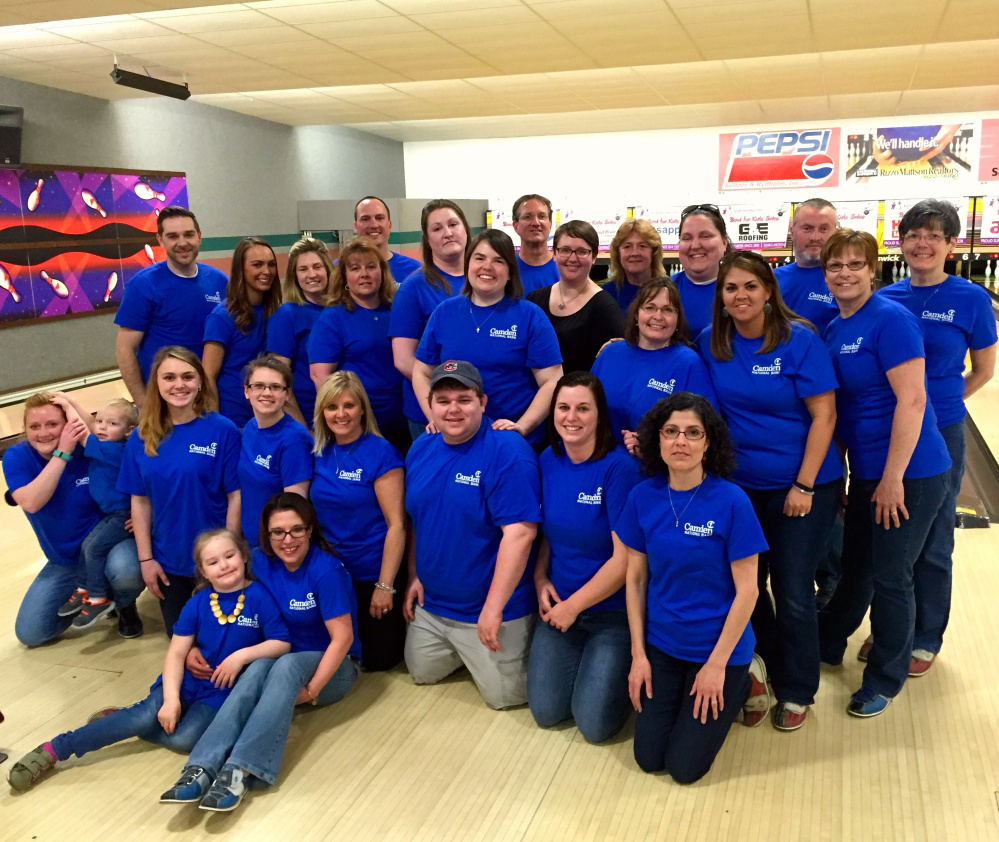 More than 170 Camden National Bank employees recently joined efforts to support Big Brothers Big Sisters of Mid-Maine at Bowl For Kids' Sake. One of the Kennebec county teams, included, sitting, from left, Ursula Godin and daughter Morgan Buswell; first row, from left, Alisha Robinson and son Brayden Kramer, Taylor Banister, Makala Ouellette, Donna York, Wes Huckey, Leanne Churchill and Lucie Glover; second row from left, Ken Demuth, Amanda Gagnon, Alicia Beaulieu, Tricia Harriman, Holly Morin, Morgan Huckey, Kate Labbe, Amy Black, Nikki Shaw and Pat Harris; and back row, from left, Nate Cotnoir, Robert Black, Carol Oliver, Lisa Buzzell, Chip Shaw and Carolyn Moss.