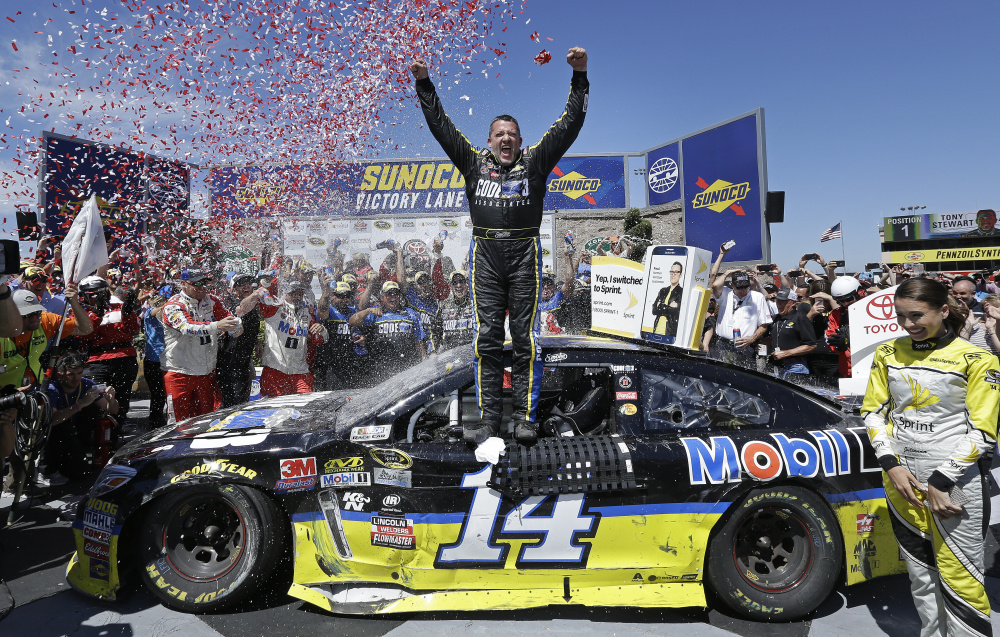 Tony Stewart, center, celebrates after winning the NASCAR Sprint Cup Series race Sunday in Sonoma, California.