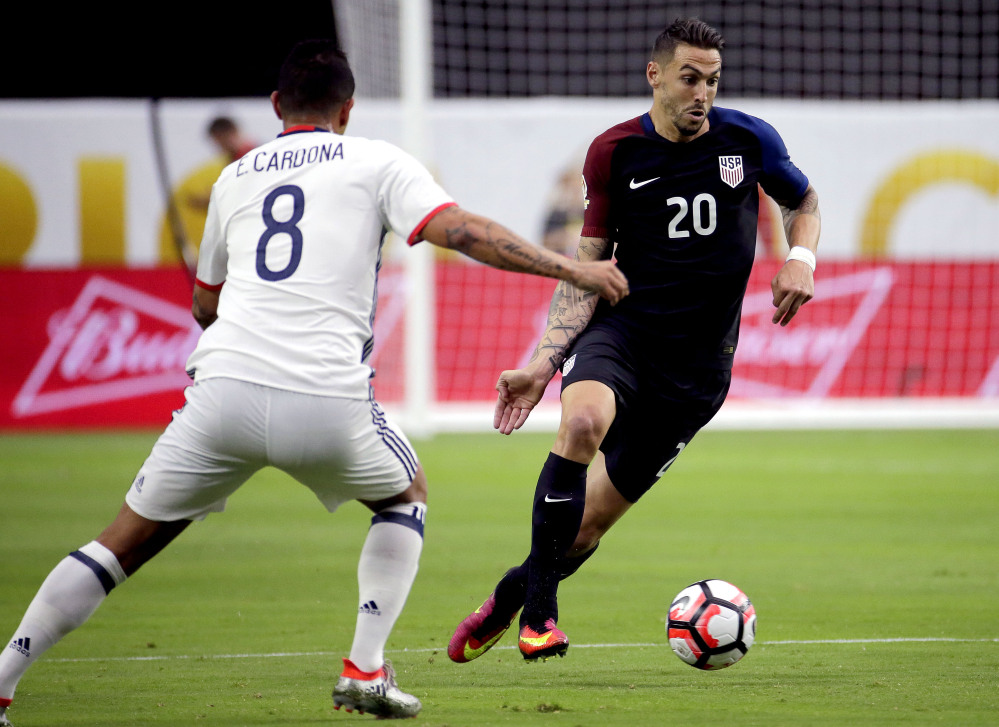 United States defender Geoff Cameron (20) is defended by Colombia midfielder Edwin Cardona (8) during the Copa America Centenario third-place soccer match at University of Phoenix Stadium on Saturday in Glendale, Arizona.