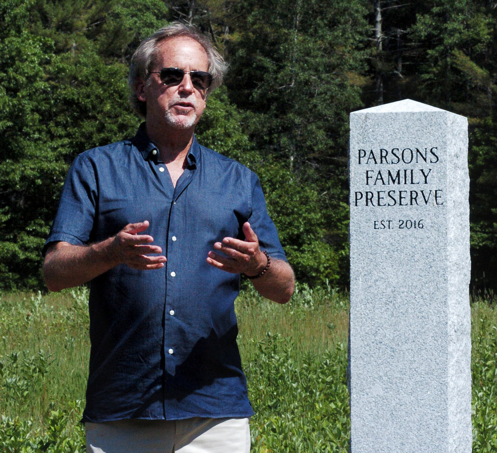 Standing beside a monument marking the Parsons Family Preserve on Sunday, John Parsons speaks about the long history of family-owned land along Malbons Mills Road in Skowhegan. The dedication of the preserve was attended by family members and the Somerset Woods Trustees. The will remain undeveloped and open to the public.