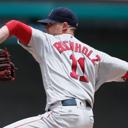 Boston Red Sox starting pitcher Clay Buchholz throws during the first inning against the Texas Rangers on Sunday in Arlington, Texas. Buchholz allowed five runs, four earned, on seven hits.