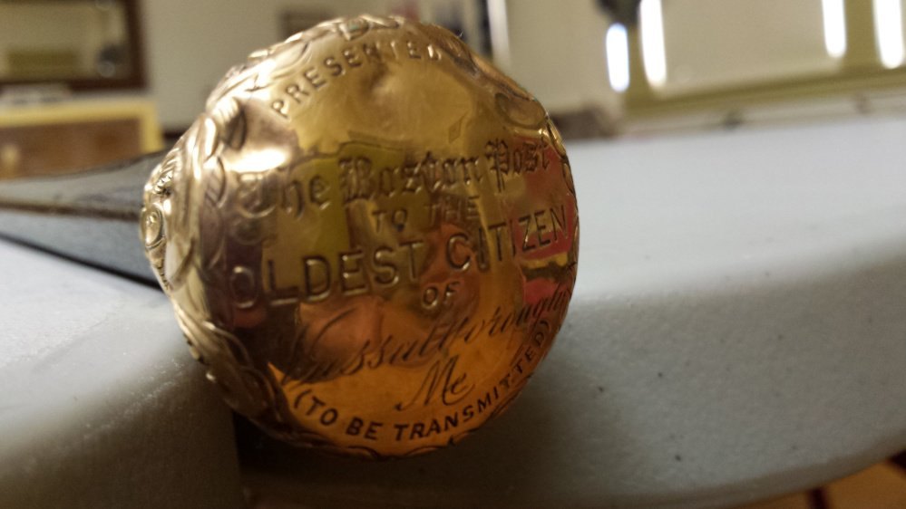 Vassalboro's Boston Post Cane, which is in the possession of the Vassalboro Historical Society, will be presented to the oldest resident in town at Vassalboro Days in September if the society can find the person.