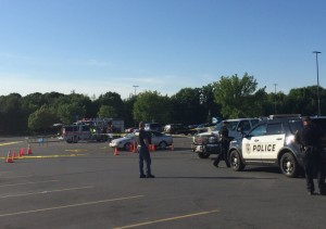 Police work the scene Sunday evening at the Wal-Mart parking lot in Augusta after a fight that resulted in shots being fired.