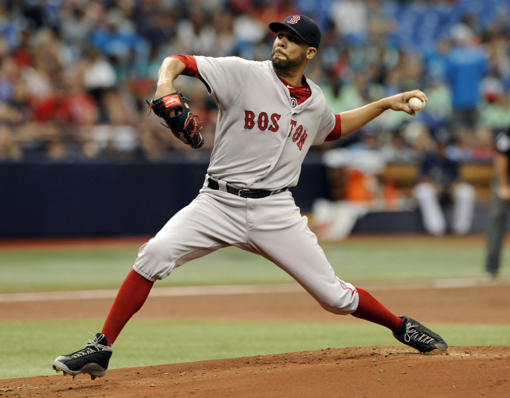 Boston Red Sox starter David Price pitches against the Tampa Bay Rays during the first inning Wednesday in St. Petersburg, Florida.