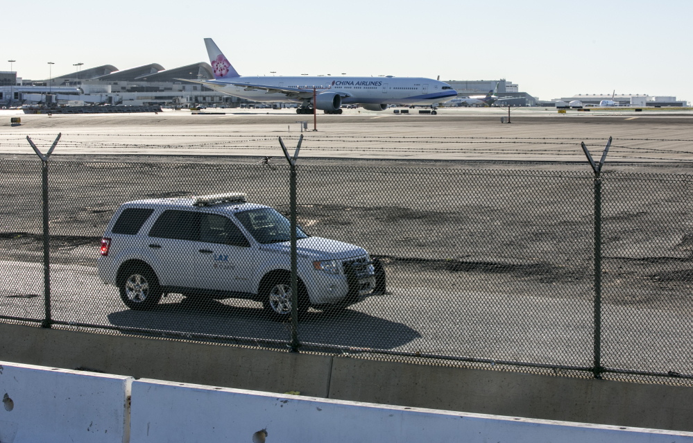 A security vehicle patrols the perimeter of the Los Angeles International Airport.