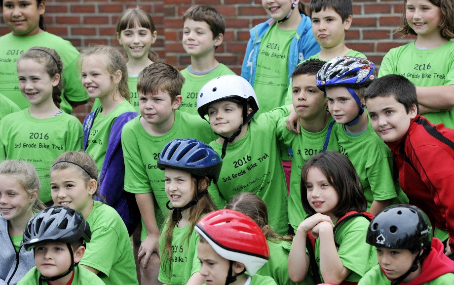 Third-graders gather for a group photo before they head out on the Henry L. Cottrell School's annual bike ride to a beach in Monmouth in late May.    Shawn Patrick Ouellette/ Staff Photographer