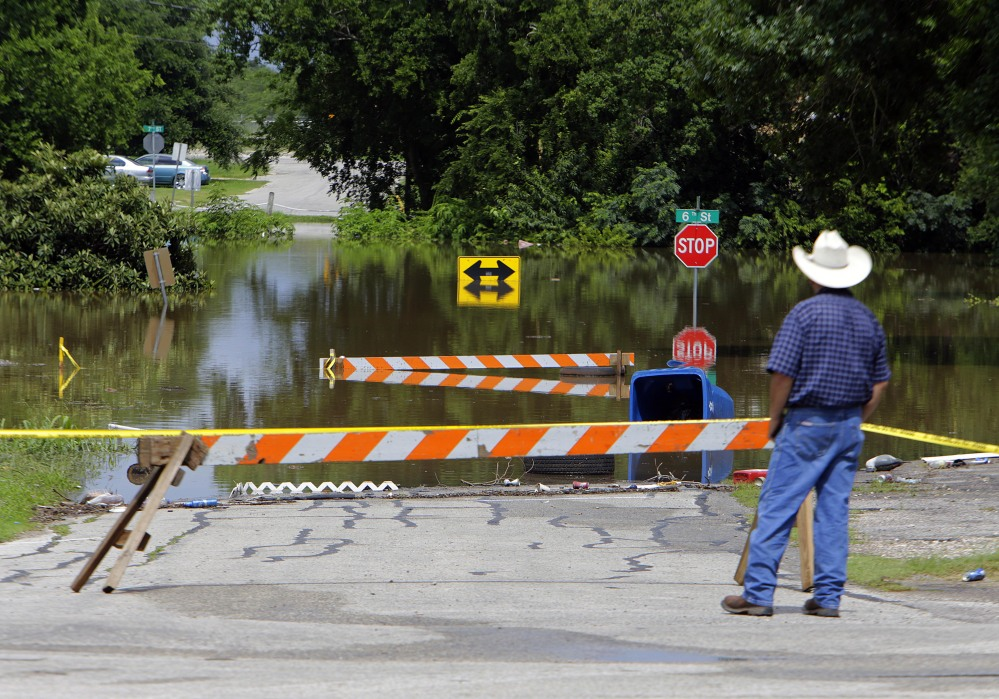 Streets along the Brazos River are closed Thursday in Rosenber, Texas. In Fort Hood, searchers seek four soldiers who are missing after their truck overturned in floodwaters.