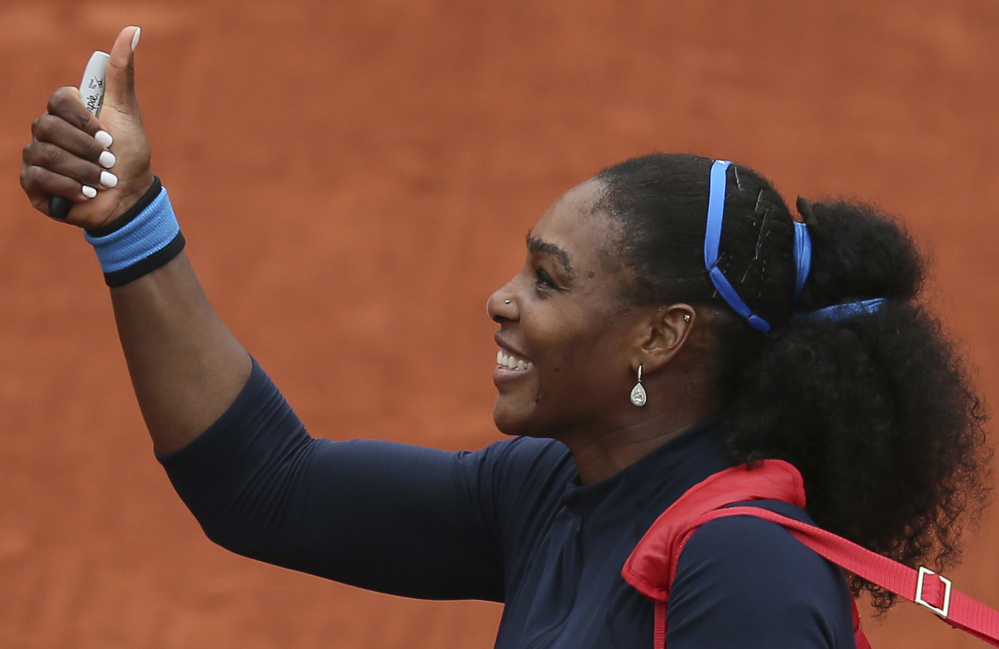 Serena Williams celebrates after defeating Kazakhstan's Yulia Putintseva 5-7, 6-4, 6-1, in the quarterfinals of the French Open. Williams is seeking a 22nd Grand Slam title, which would tie the modern record.