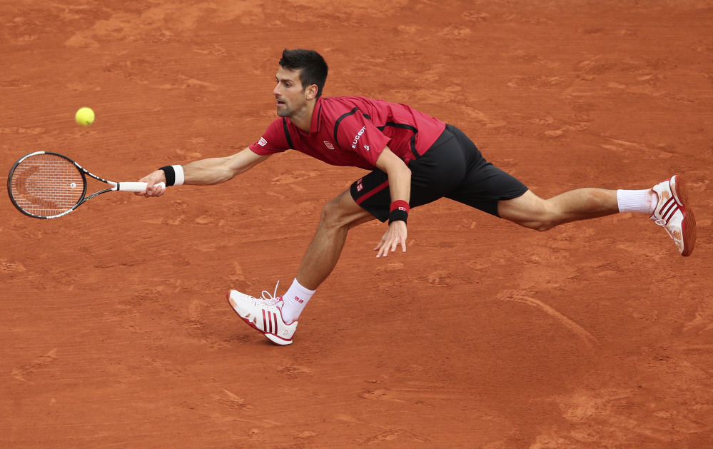 Serbia's Novak Djokovic stretches to return the ball to Britain's Andy Murray during their final match of the French Open tennis tournament at the Roland Garros stadium, Sunday, June 5, 2016 in Paris.