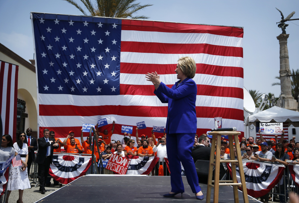 Democratic presidential candidate Hillary Clinton attends a rally on Monday in Lynwood, Calif. An Associated Press count finds that she has the delegate commitments needed to secure the party's nomination for president.