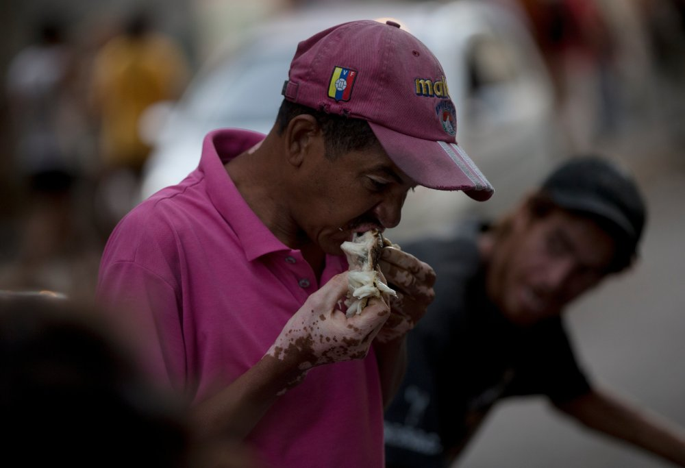 Venezuelans who once considered themselves middle class now rummage through garbage for rotten fruit and vegetables as an economic crisis engulfs the country.