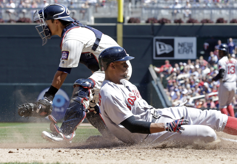 Boston's Xander Bogaerts, right, scores from third on a sacrifice fly by Hanley Ramirez in the sixth inning of the Red Sox' 15-4 win over the Minnesota Twins on Saturday in Minneapolis. Bogaerts was 4 for 5 with a home run, a double, four runs scored and three RBI.