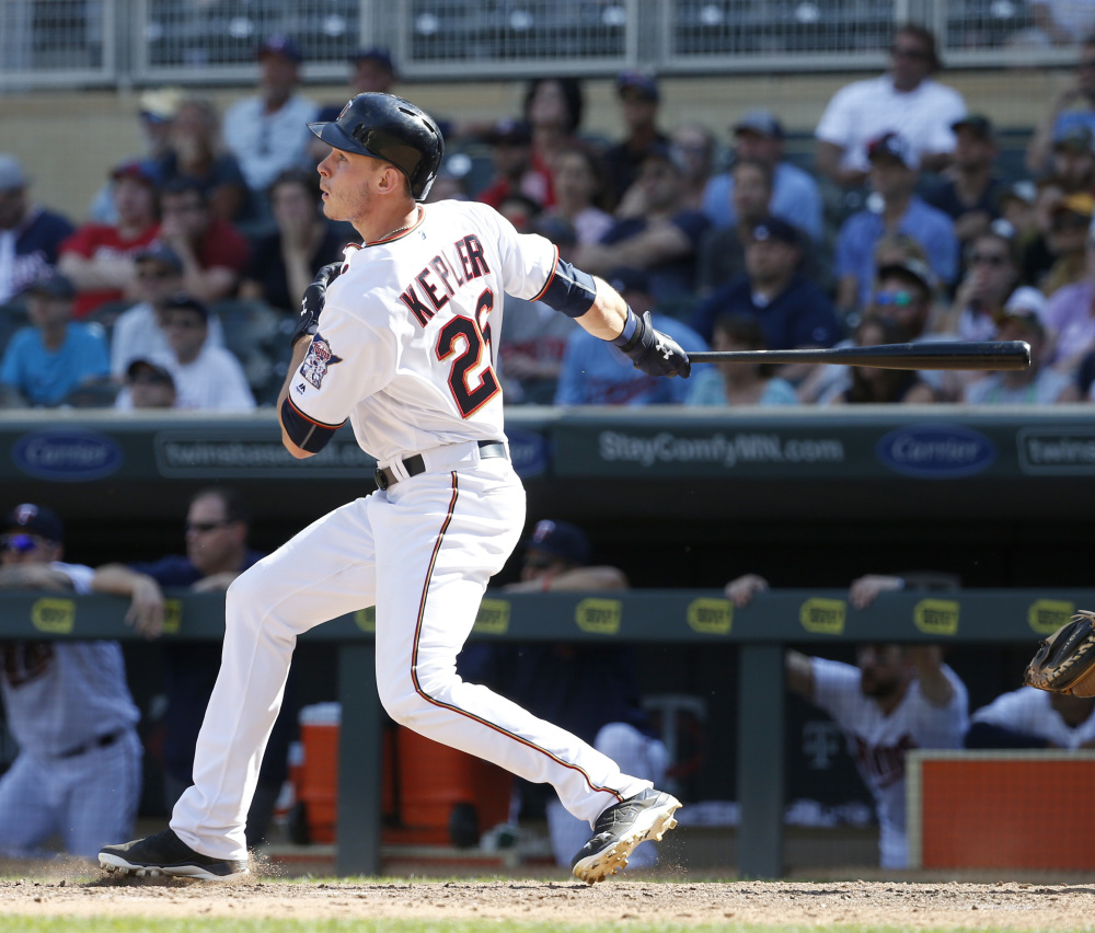 Minnesota's Max Kepler hits a three-run home run in the bottom of the 10th inning off Boston reliever Matt Barnes to give the Twins a 7-4 win Sunday in Minneapolis.