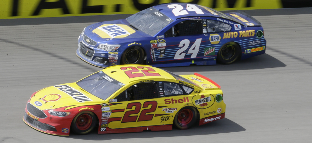Joey Logano, bottom, pulled away from 20-year-old Chase Elliott, top, to win the Sprint Cup race Sunday at Michigan International Speedway. Logano, Elliott and Kyle Larson set a NASCAR record as the youngest top three in Sprint Cup history.