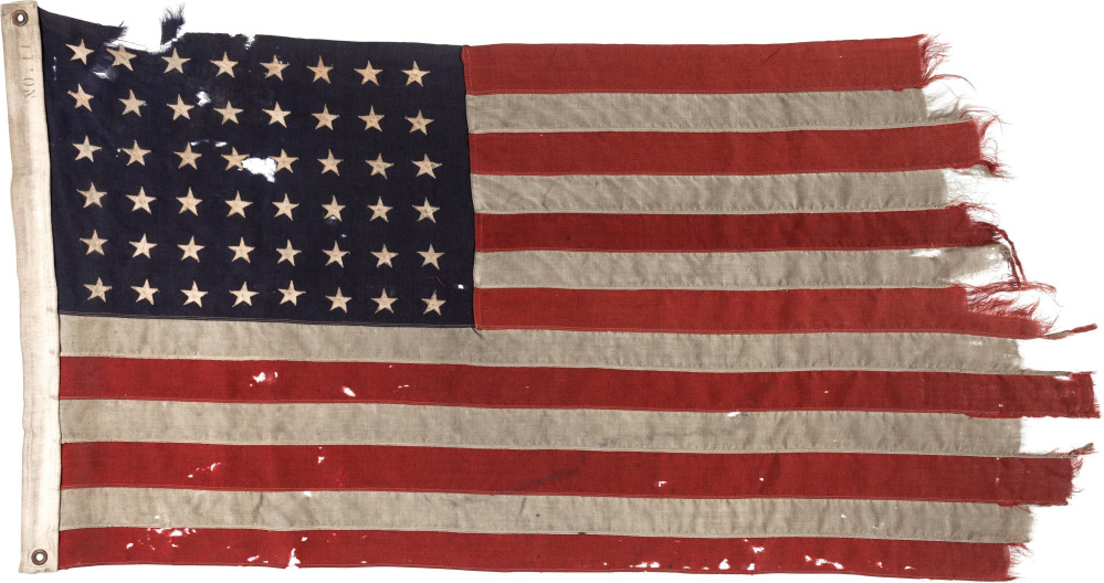 A 48-star U.S. flag flown on the stern of the guide boat that led the first American troops onto Utah Beach on D-Day appears in photo provided by Heritage Auctions.