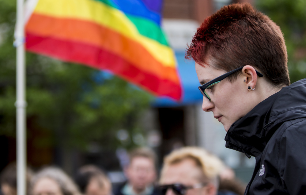 Skyler Keiter of South Portland spoke about the mass shooting in Orlando during Sunday's vigil in Monument Square in Portland. Other vigils were scheduled around the state Monday.