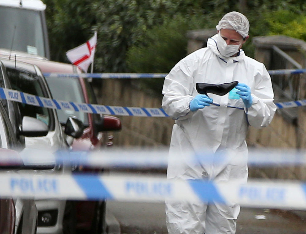 A forensics officer looks at a shoe at the scene after Labour MP Jo Cox was killed in an attack in her constituency, in Birstall, West Yorkshire, England, on Thursday.