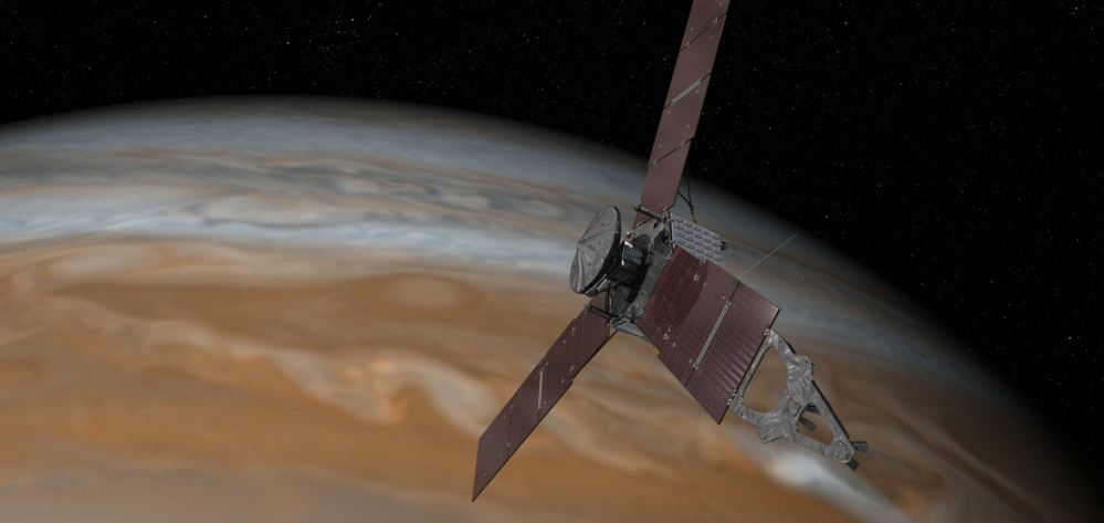 This artist's rendering made available by NASA/JPL-Caltech on July 7, 2015 shows the Juno spacecraft above Jupiter. The spacecraft is scheduled to arrive at the planet on July 4 to begin a nearly year-long study of the gas giant.