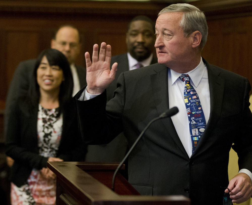 Mayor Jim Kenney walks to the podium for a news conference Thursday at City Hall in Philadelphia, which became the first major American city with a soda tax.