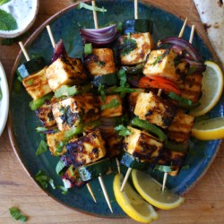 Spicy grilled paneer can be grilled without melting so that it softens in the middle and chars on the edges.   Associated Press/Meera Sodha