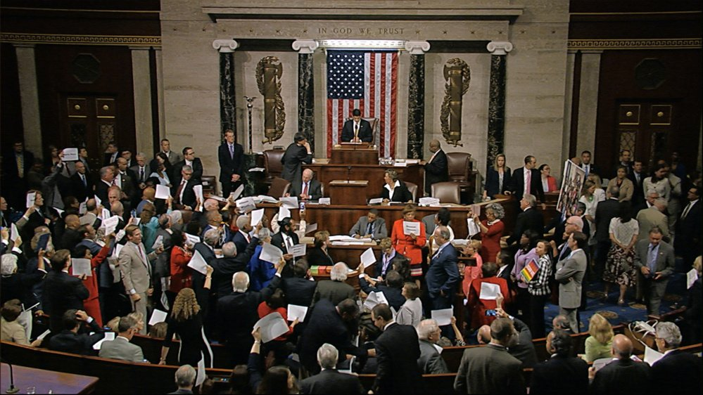 """Angry Democrats shout """"No bill, no break!"""" while waving pieces of paper with the names of gun victims as Speaker Paul Ryan tries to reconvene the House on Wednesday night. After Ryan tried to ignore the outbursts, Democrats began singing """"We Shall Overcome."""""""