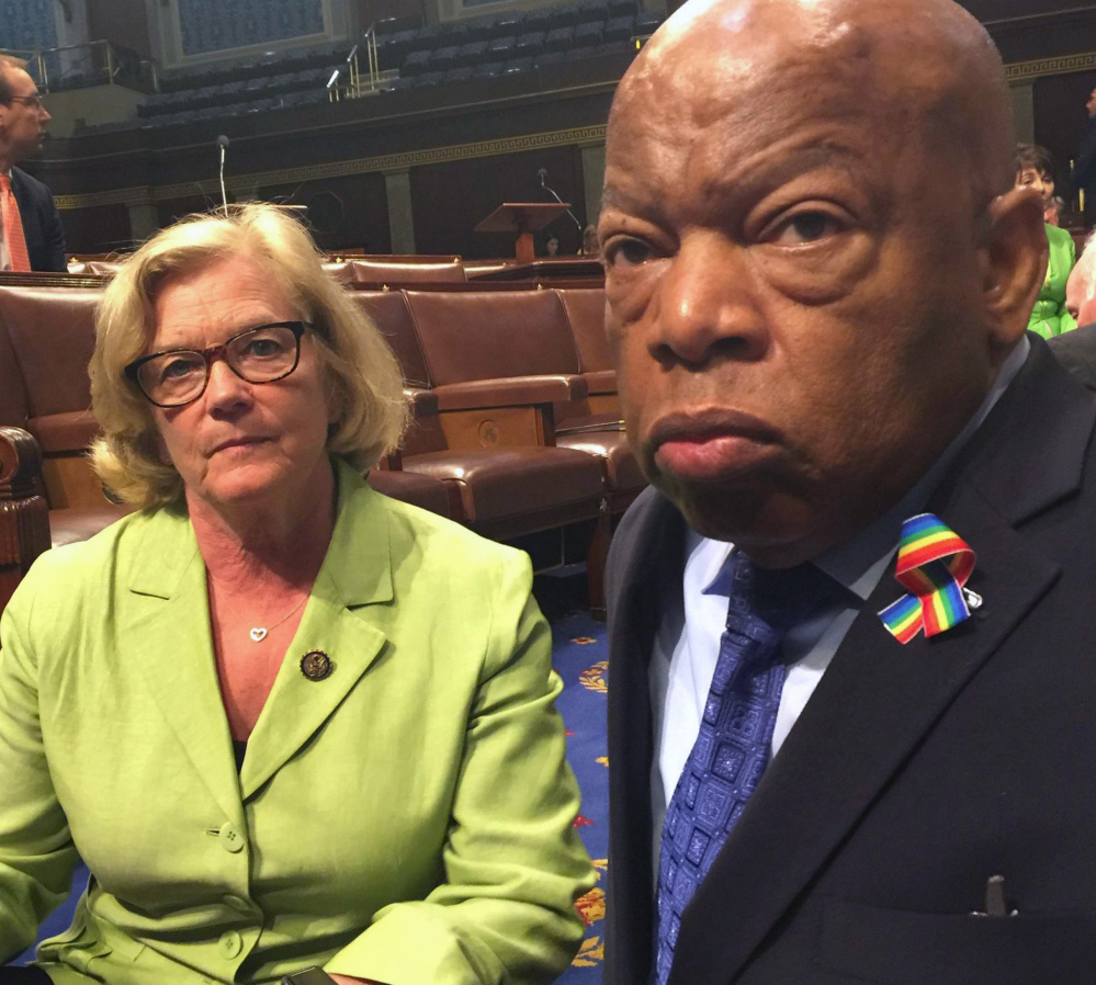Maine Rep. Chellie Pingree sits with the Democrats' protest leader, Rep. John Lewis of Georgia, in the well of the House on Wednesday.
