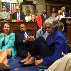 """A photo shot and tweeted from the floor of the U.S. House of Representatives shows Democrats staging a sit-in Wednesday on the House floor """"to demand action on common-sense gun legislation."""""""
