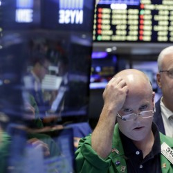 Trader Kevin Walsh, second from right, works on the floor of the New York Stock Exchange on Friday. U.S. stocks plunged in early trading after Britons voted to leave the European Union.